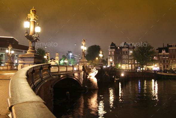 Bridge over the Amstel river at night in Amsterdam - Stock Photo - Images