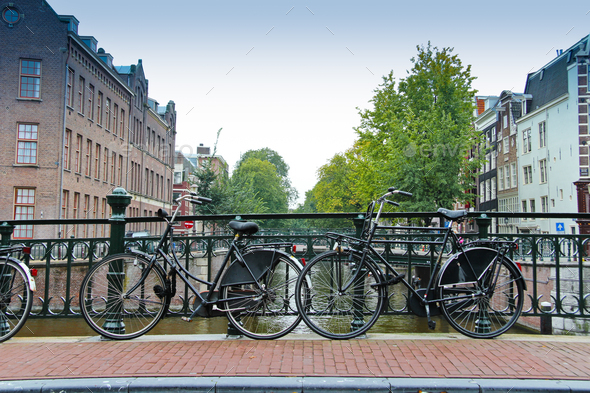 Couples of bikes over the canal of Amsterdam - Stock Photo - Images