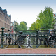 Couples of bikes over the canal of Amsterdam - PhotoDune Item for Sale