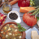 Close-up view of a wooden table with a fresh, ready-to-eat homemade vegetable soup. - PhotoDune Item for Sale