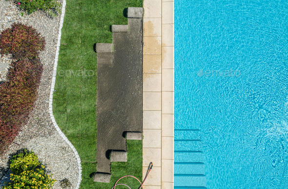 Outdoor Swimming Pool and Lawn Finishing Aerial View. - Stock Photo - Images
