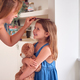 Mother Measuring Daughter's Height And Marking On Wall At Home - PhotoDune Item for Sale
