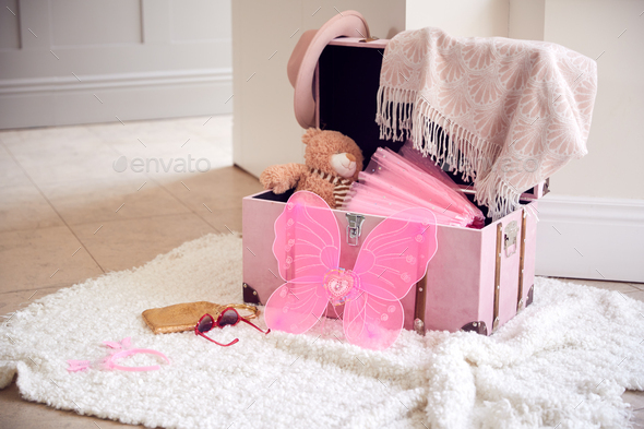 Open Dressing Up Box With Clothes On Floor At Home - Stock Photo - Images