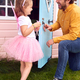 Father With Daughter Wearing Fairy Costume Playing Outdoors In Garden By Playhouse - PhotoDune Item for Sale