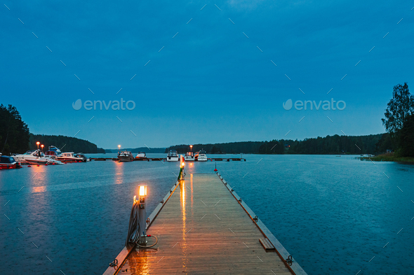 Sweden. Beautiful Wooden Pier Near Lake In Summer Evening Night. Lake Or River Landscape - Stock Photo - Images