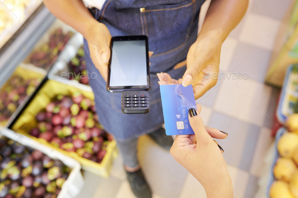 Woman paying for purchase - Stock Photo - Images