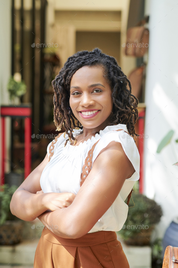 Afrrican woman standing outdoors - Stock Photo - Images