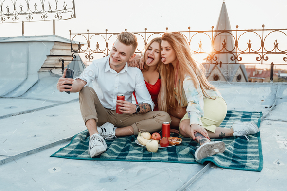 Carefree friends taking shot together at top - Stock Photo - Images