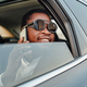 Happy african businessman with phone inside of car - PhotoDune Item for Sale