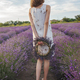 Dreamy teenager girl with floral wreath sits in lavender field. Beauty of nature, summer lifestyle - PhotoDune Item for Sale