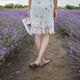 Dreamy teenager girl walks in lavender field. Beauty of nature, summer lifestyle, back view - PhotoDune Item for Sale
