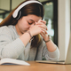 Young asian girl holding hands and head down tired expression while studying online with laptop. - PhotoDune Item for Sale