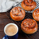 Freshly baked traditional Swedish cinnamon buns Kanelbulle with cup of coffee or cappuccino - PhotoDune Item for Sale