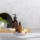 Different kinds of hygiene and cosmetic products near white marble wall in bathroom - PhotoDune Item for Sale