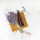 Flat lay composition with lavender flowers and natural cosmetic on white marble background - PhotoDune Item for Sale