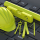 Spirit bubble level hardhat and design accessories on laptop keyboard. 3d illustration - PhotoDune Item for Sale