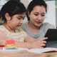 Young asian girl siblings looking at tablet,Two asian girls using tablet. - PhotoDune Item for Sale
