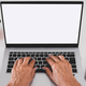 Close up on mature woman's hands typing using laptop computer. - PhotoDune Item for Sale