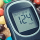 Glucose meter for checking sugar level and heap of sweets containing a lot of sugar - PhotoDune Item for Sale