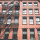Old red brick building with iron fire escape, New York City, USA. - PhotoDune Item for Sale