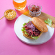 Pastrami burger with mustard, beer and pickels over bright pink background - PhotoDune Item for Sale