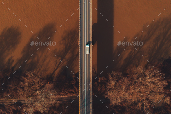 Aerial view of mini-truck crossing the bridge - Stock Photo - Images