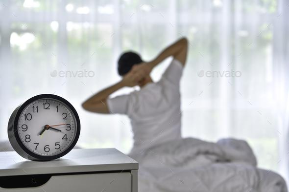 Man waking up - Stock Photo - Images
