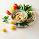 Homemade hummus, pita slices and rainbow vegetables - PhotoDune Item for Sale