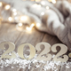 Cozy holiday composition with the numbers 2022 on a blurred background in bokeh. - PhotoDune Item for Sale