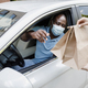 Black guy driver in face mask taking take away food - PhotoDune Item for Sale