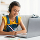Girl using laptop, having videocall with teacher, writing in notebook - PhotoDune Item for Sale