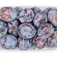 Ripe prune plums, fresh freestone fruits in a clear plastic container - PhotoDune Item for Sale