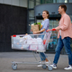 Family couple with cart on market car parking - PhotoDune Item for Sale