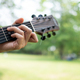 guitar chord played outdoors in a park with trees as background - PhotoDune Item for Sale