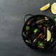 Pan with fresh mussels on dark wooden table - PhotoDune Item for Sale