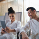 Portrait of young couple relaxing in spa resort, using tablet - PhotoDune Item for Sale