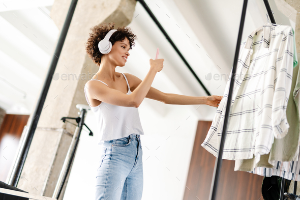 Young woman chooses clothes in the wardrobe closet - Stock Photo - Images