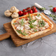 Rectangular pizza with mushrooms, tomatoes and arugula on a wooden cutting board - PhotoDune Item for Sale