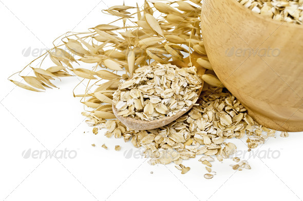 Oat flakes in a bowl and spoon - Stock Photo - Images