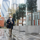 Happy business senior man walking to work on autumn rainy day - Focus face - PhotoDune Item for Sale