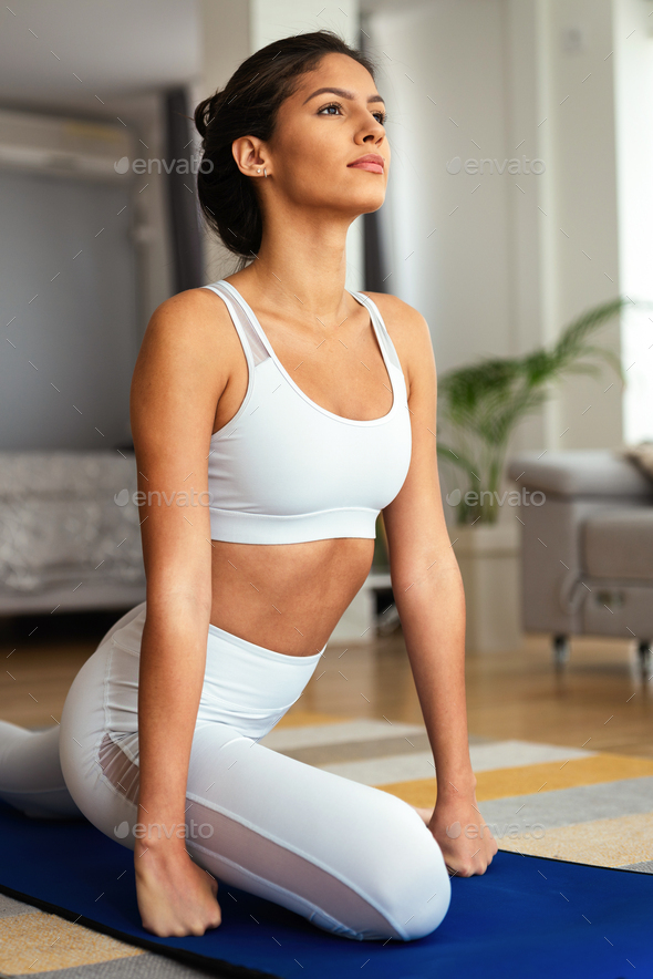 Fit sport woman exercising and training at home - Stock Photo - Images