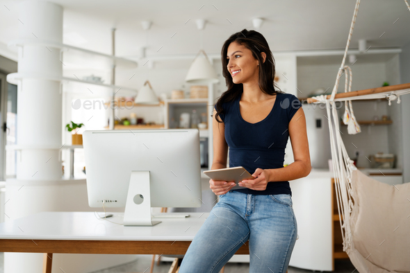 Happy beautiful woman using, working on computer. Technology, people concept - Stock Photo - Images