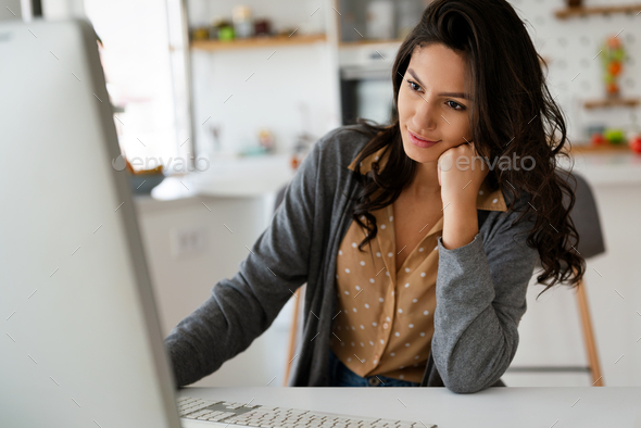Beautiful student woman learning online on computer at home. Technology, education concept - Stock Photo - Images