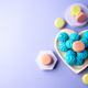 Heart shaped wooden dish with blue sweet meringues and macaroons - PhotoDune Item for Sale