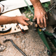 Auto mechanic repairing the brake system of car - PhotoDune Item for Sale