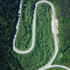 Flight over the summer mountains with mountain road serpentine - PhotoDune Item for Sale