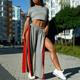 Fashionable sporty woman posing near multistorey buildings - PhotoDune Item for Sale