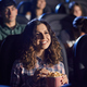 Young laughing woman eating popcorn in cinema - PhotoDune Item for Sale