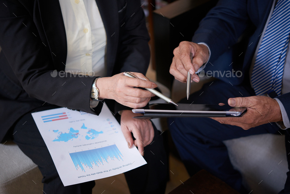 Business People Discussing Financial Matter - Stock Photo - Images