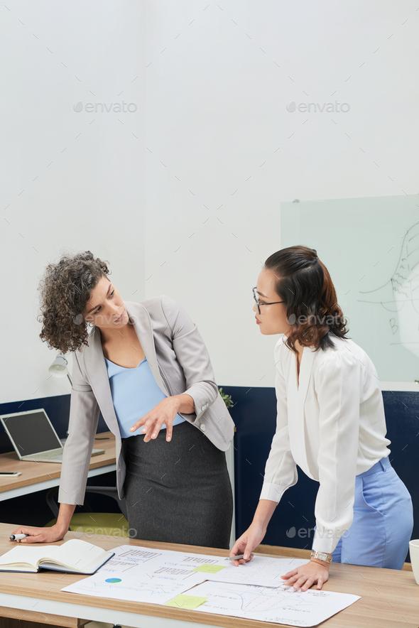 Entrepreneur Discussing Statistics Document - Stock Photo - Images